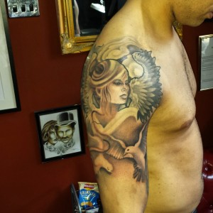 half sleeve religious tattoo by louis santos