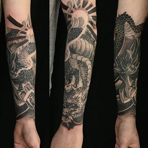 black and grey dragon half sleeve by Joe Galloway